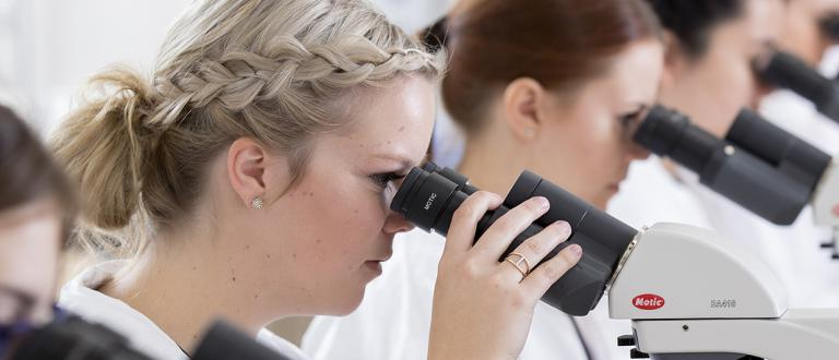 Medical Laboratory Assistant Certificate - students looking in microscropes